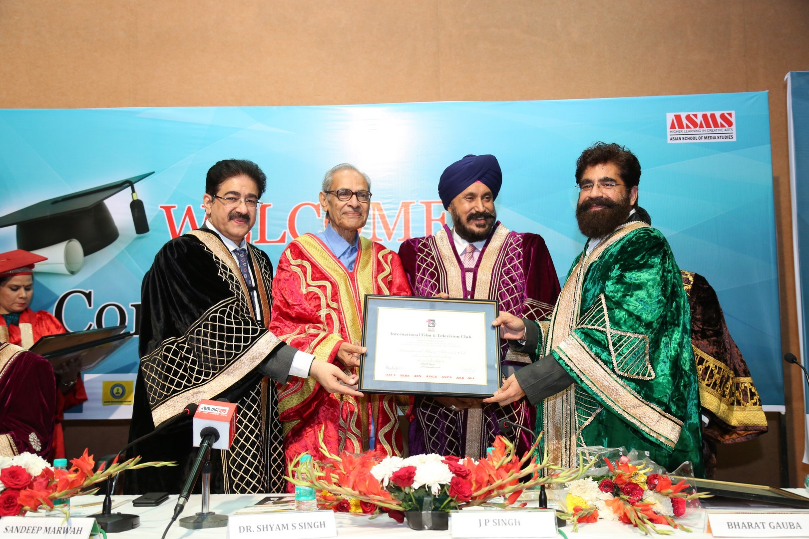 J P Singh Director ISD Council is distributing awards at Marwah Studio with Sandeep Marwah